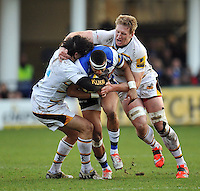 Anthony Watson of Bath Rugby is double-tackled in possession. Aviva Premiership match, between Bath Rugby and Wasps on January 10, 2015 at the Recreation Ground in Bath, England. Photo by: Patrick Khachfe / Onside Images