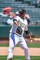 Atahualpa Severino (18) of the Salt Lake Bees delivers a pitch to the plate against the Fresno Grizzlies in Pacific Coast League action at Smith's Ballpark on June 14, 2015 in Salt Lake City, Utah.  (Stephen Smith/Four Seam Images)