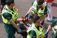 Quinton Fortune<br /> carried away by St John's Ambulance at the finish line on The Mall at the 2017 London Marathon, London. <br /> <br /> <br /> ©Ash Knotek  D3254  23/04/2017