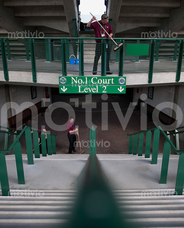 Workforce cleans an entrance and signs around Court 1. Preparation for The Wimbledon Championships 2010 The All England Lawn Tennis & Croquet Club  Sunday Pre Championships Sunday 21/06/2010
