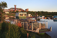 A barge of cows awaits departure for the islands in front of the former sugar beet factory, which will soon be transformed into a biofuel manufacturing plant.