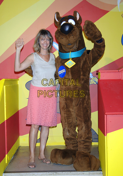 SABRINA GUINESS & SCOOBY DOO.At the press launch and photocall for YCTV's 10th Anniversary and the launch of The Toon Room Animation Suite, London, July 13th 2005..full length costume dressed up funny waving.Ref: PL.www.capitalpictures.com.sales@capitalpictures.com.©Capital Pictures
