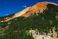 Aptly named Red Mountain looms over one of the richest silver mines ever discovered in the San Juan Mountains of Colorado, the Yankee Girl Mine. The red color is caused by iron ore containing minerals on the surface of the mountain.