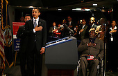 Washington, DC - March 16, 2009 -- United States President Barack Obama recites the Pledge of Allegiance prior to speaking to a gathering of employees at the Department of Veterans Affairs (VA), Washington, DC, Monday, March 16, 2009. Behind the president is Veterans Affairs Secretary Eric Shinseki. At right (in wheelchair) is Mahdee Abdul Sabir, a disabled Vietnam Veteran who currently works at the VA on compliance issues with the Americans with Disabilities Act (ADA)..Credit: Martin H. Simon / Pool via CNP