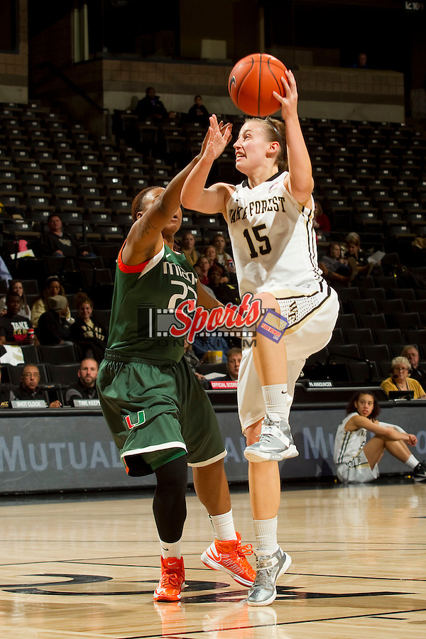 Millesa Calicott (15) of the Wake Forest Demon Deacons shoots over Shanel Williams (23) of the Miami Hurricanes at the LJVM Coliseum on January 24, 2013 in Winston-Salem, North Carolina.  The Hurricanes defeated the Demon Deacons 79-78.    (Brian Westerholt/Sports On Film)