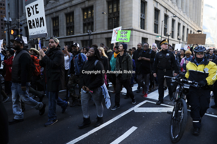 Protesters calling on Chicago Mayor Rahm Emanuel to resign march down Clark Street from City Hall in the Loop in Chicago, Illinois on December 9, 2015.  Emanuel offered a historic apology for the police killing of Laquan McDonald and police brutality and racial profiling generally -- without using those words -- in front of the City Council in the morning.