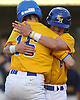 Paul Miano #1, right, and Joe Gangi #15 of  East Meadow celebrate after they both scored on a double by #9 Frank Ippolito (not in picture) in the bottom of the first inning in Game 3 of the Nassau County varsity baseball Class AA finals against Massapequa at Farmingdale State College on Wednesday, June 1, 2016. East Meadow led 5-0 after four innings.