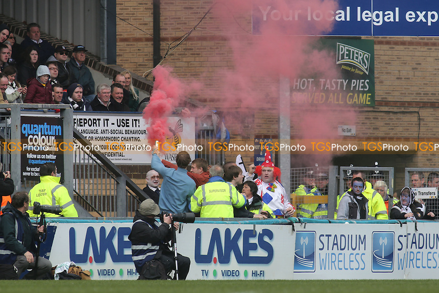 Port Vale fans let off a red flare at Adams Park - Wycombe Wanderers vs Port Vale - NPower League Two Football at Adams Park, High Wycombe - 27/04/13 - MANDATORY CREDIT: Paul Dennis/TGSPHOTO - Self billing applies where appropriate - 0845 094 6026 - contact@tgsphoto.co.uk - NO UNPAID USE.
