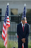 United States President Barack Obama observes a moment of silence during the 12th anniversary commemoration of the 9/11 terrorist attacks at the Pentagon Memorial at the Pentagon in Washington, DC on September 11, 2013. Nearly 3,000 people were killed in the attacks in New York, Washington and Shanksville, Pennsylvania.  <br /> Credit: Pat Benic / Pool via CNP