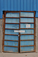 Paper strip. seal the closed factory warehouse door belonging to Smart Union, one of several factories in Zhang Mutou in South China that went bankrupt in the current credit crisis. Smart Union, that produced toys for Mattel amongst others, left 6,000 workers jobless and penniless after they could not pay the salaries. Hundreds of factories in South China are closing due to increased labor and material costs and the current credit crissis is exasperating. The problem leaving ghost towns behind. .24 Oct 2008