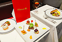 McDonald's special dinner created by chef Masayo Waki on display during the ''Restaurant M'' event in the posh Roppongi Hills area on July 27, 2015, Tokyo, Japan. 20 chosen diners (from 8,300 applications) ate a special multi-course dinner created by the celebrity chef using ingredients from the restaurant chain's regular menu. The special one-night only event was organized to celebrate the launch of its new summer menu ''Fresh Mac,'' which features fresh vegetables. The five-course meal served on a white tablecloth with plates and proper cutlery included a Vichyssoise en Pommes de terre de McDonald, Mousse au Poivron Rouge, Salade en Gelee aux Legumes de McDonald, Cinq Pinchos des McDonald Patties avec leur Sauces, a choice of main dish including the Fresh Mac Bacon Lettuce Burger, and a McFlurry Mixed Berry Oreo dessert with a Premium Roast Coffee. (Photo by Rodrigo Reyes Marin/AFLO)