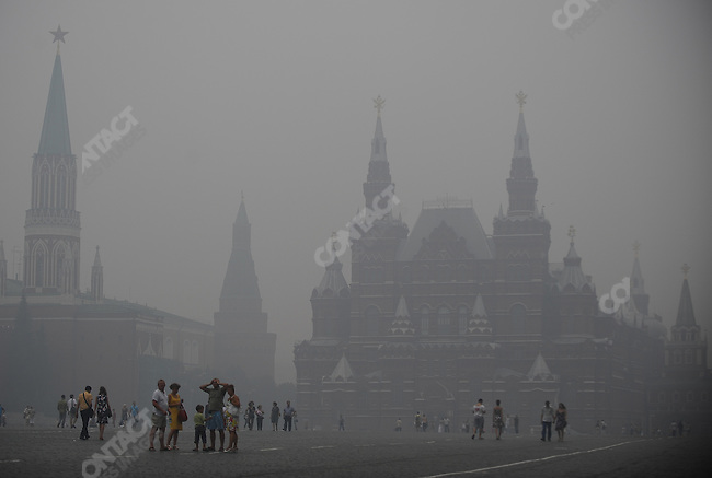 In the early evening on Red Square, Moscow, a heavy smog from burning peat fires outside the Russian capital hung over those walking across the famous landmark. 04 August 2010