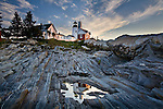 Pemaquid Point Lighthouse reflected in a tide pool in Bristol, ME, USA