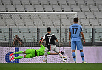 Calcio, Serie A: Juventus - Lazio, Allianz Stadium, July 20, 2020.<br /> Juventus' Cristiano Ronaldo (c) kicks a penalty and scores during the Italian Serie A football match between Juventus and Lazio at the Allianz stadium in Turin, July 20, 2020.<br /> UPDATE IMAGES PRESS/Isabella Bonotto