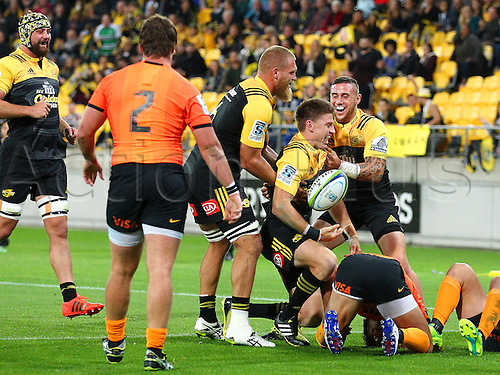 09.04.2016. Wellington, New Zealand.  Hurricanes' Beauden Barrett celebrates with TJ Perenara & Brad Shields after scoring a try during the Round 7 Super Rugby match, Hurricanes  versus Jaguares at Westpac Stadium, Wellington. 9th April 2016.