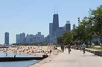 Along Chicago's Lakefront Trail, across from Lincoln Park, the sandy shores and lapping waters of Lake Michigan prescribe the perfect fix for a hot sunny summer day.