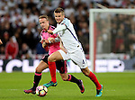 Leigh Griffiths of Scotland tussles with Eric Dier of England during the FIFA World Cup Qualifying Group F match at Wembley Stadium, London. Picture date: November 11th, 2016. Pic David Klein/Sportimage