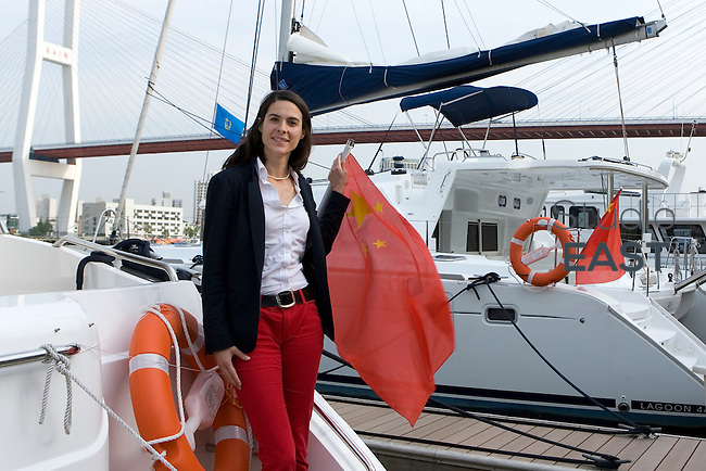 China Rendez-Vous' Managing Director Delphine Lignieres poses for a photograph on a boat in Shanghai Yacht Club, by the Huangpu river and near Nanpu bridge, in Shanghai, China, on May 12, 2010. Photo by Lucas Schifres/Pictobank