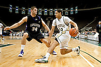 January 14, 2010:    Jacksonville guard Tevin Galvin (23) trives to drive past Lipscomb center Adnan Hodzic (34) during Atlantic Sun conference game action between the Jacksonville Dolphins and the Lipscomb Bisons at Veterans Memorial Arena in Jacksonville, Florida.  Jacksonville defeated Lipscomb 79-73.