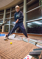 NWA Democrat-Gazette/BEN GOFF @NWABENGOFF<br /> Collin Orvin, 12, of Fayetteville putts on one of the holes Friday, Nov. 30, 2018, during teen mini golf night at the Fayetteville Public Library. Staff from each department at the library designed and built each hole with a unique theme. Staff counted fifty children and teens in attendance at the event.