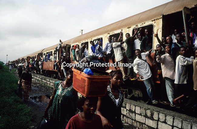 An early morning commuter train full of people arrives at a station on February 28, 2002 in central Kinshasa, Congo-DRC. The country has hardly any infrastructure and people rely on riverboats and planes, when they travel around the country. The Congolese economy and infrastructure is in total disarray after 40 years of independence from Belgium. The former strongman Mobuto Sese Seko fleeced the country and he died in exile in 1997. (Photo by: Per-Anders Pettersson)