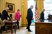 Attorney General Jeff Sessions (R), U.S. President Donald J. Trump (C-R), Sessions' wife, Mary Blackshear Sessions (C-L) and Vice President Mike Pence (L) attend the swearing-in of Sessions as attorney general in the Oval Office of the White House in Washington, DC, USA, 09 February 2017. On 08 February, after a contentious battle on party lines, the Senate voted to confirm Sessions as attorney general.<br /> Credit: Jim LoScalzo / Pool via CNP
