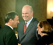 Washington, D.C. - September 12, 2005 -- Judge John G. Roberts, left, shares a light moment with former United States Senator Fred Thompson (Republican of Tennessee), who is serving as a White House advisor on the nomination process, center, and his wife, Jane Marie Sullivan, right, during a break in opening remarks at the United States Senate Committee on the Judiciary hearing on Roberts' nomination of  to be Chief Justice of the United States..Credit: Ron Sachs / CNP