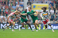 James Short of London Irish looks to had off Matt Hopper of Harlequins during the Premiership Rugby Round 1 match between London Irish and Harlequins at Twickenham Stadium on Saturday 6th September 2014 (Photo by Rob Munro)