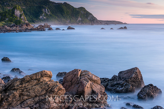 Pink twilight on rocky beach near Punakaiki, Paparoa National Park, Buller Region, West Coast, New Zealand, NZ