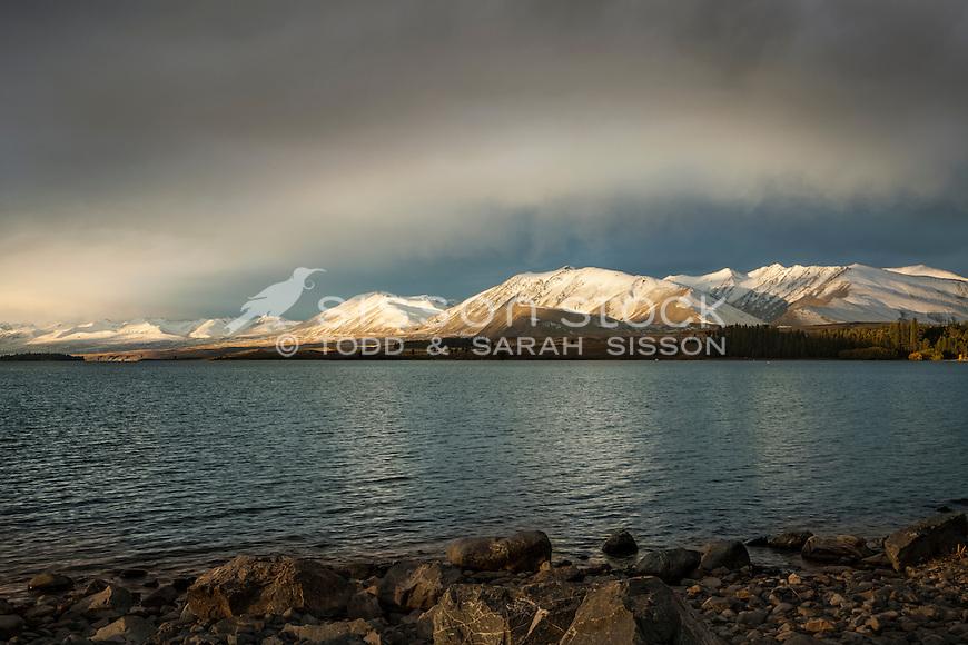 Evening light & dramatic clouds over Two Thumb Range, Lake Tekapo South Canterbury New Zealand