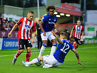 Lincoln City's Jack Payne is tackled by Everton's Lucas Digne<br /> <br /> Photographer Andrew Vaughan/CameraSport<br /> <br /> The Carabao Cup Second Round - Lincoln City v Everton - Wednesday 28th August 2019 - Sincil Bank - Lincoln<br />  <br /> World Copyright © 2019 CameraSport. All rights reserved. 43 Linden Ave. Countesthorpe. Leicester. England. LE8 5PG - Tel: +44 (0) 116 277 4147 - admin@camerasport.com - www.camerasport.com