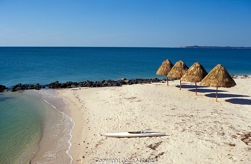 Kayak on a white sand beach on the Gulf of Mexico near the city of Campeche, Mexico