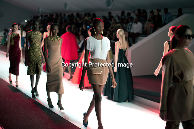 JOHANNESBURG, SOUTH AFRICA OCTOBER 29: Models (sixteen year old Nigerian model Favor Lucky in middle) walking for the Mozambican designer label Taibo Bacar on the catwalk during a show at Mercedes Benz Africa fashion week Africa on October 29, 2014 held at Melrose Arch in Johannesburg, South Africa. Designers from all over Africa showed their best collections at the yearly event. (Photo by: Per-Anders Pettersson)