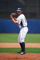 GCL Rays pitcher Collin Chapman (18) gets ready to deliver a pitch during the second game of a doubleheader against the GCL Red Sox on August 4, 2015 at Charlotte Sports Park in Port Charlotte, Florida.  GCL Red Sox defeated the GCL Rays 2-1.  (Mike Janes/Four Seam Images)