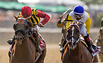 ELMONT, NY - JUNE 09: #10 Bee Jersey ridden by Ricardo Santana Jr., and #1 Mind Your Biscuits ridden by Joel Rosario battle to the finish in the Runhappy Metropolitan Handicap on Belmont Stakes Day at Belmont Park on June 9, 2018 in Elmont, New York. (Photo by Eric Patterson/Eclipse Sportswire/Getty Images)