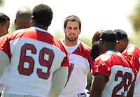 Jun 9, 2008; Tempe, AZ, USA; Arizona Cardinals quarterback (7) Matt Leinart talks with teammates in a huddle during mini camp at the Cardinals practice facility. Mandatory Credit: Mark J. Rebilas-