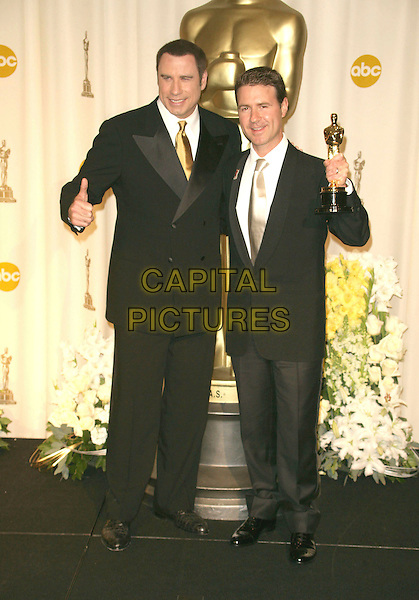 DION BEEBE & JOHN TRAVOLTA.The 78th Annual Academy Awards - Press Room, held at the Kodak Theatre, Los Angeles, California, USA, .5th March 2006..oscars full length holding oscar.Ref: ADM/RE.www.capitalpictures.com.sales@capitalpictures.com.©Russ Elliot/AdMedia/Capital Pictures.