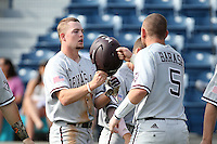 Nick Choruby (18) of the Texas A&M Aggies is greeted by teammate Michael Barash (5) after scoring during a game against the Pepperdine Waves at Eddy D. Field Stadium on February 26, 2016 in Malibu, California. Pepperdine defeated Texas A&M, 7-5. (Larry Goren/Four Seam Images)