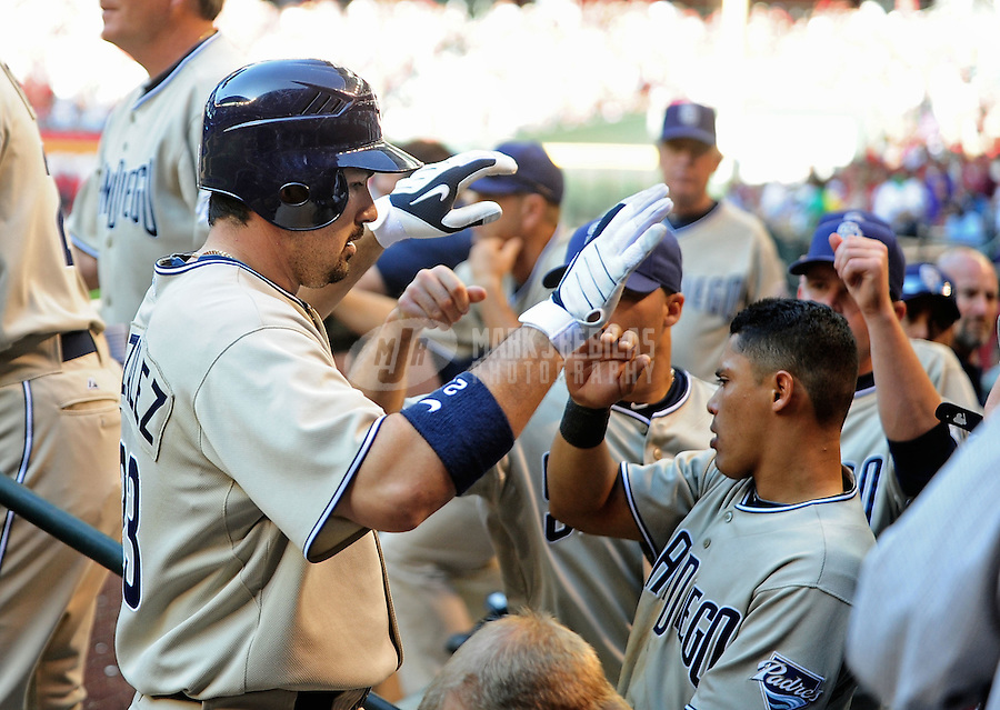 Apr. 5, 2010; Phoenix, AZ, USA; San Diego Padres first baseman Adrian Gonzalez is congratulated after hitting a solo home run in the ninth inning against the Arizona Diamondbacks during opening day at Chase Field. Mandatory Credit: Mark J. Rebilas-