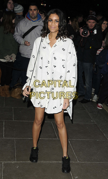 Aluna Francis of AlunaGeorge.The BRIT Awards 2013 nominations launch, Savoy Hotel, The Strand, London, England..January 10th, 2013.full length black white print numbers dress sneakers trainers shoes .CAP/CAN.©Can Nguyen/Capital Pictures.