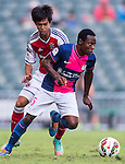 Christian Kwesi Annan of Kitchee (R) being followed by Runqiu Che of SCAA (L) during the HKFA Premier League between South China Athletic Association vs Kitchee at the Hong Kong Stadium on 23 November 2014 in Hong Kong, China. Photo by Aitor Alcalde / Power Sport Images