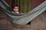 A boy rests in a hammock in the countryside near Anapu, in Brazil's northern Para State. This area was forest land until recent decades, when the expansion of the agrarian frontier led to the steady destruction of this part of the Amazon's rain forest.