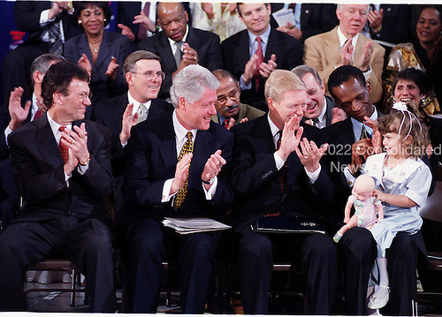 "Congressional Democratic Leaders applaud Jenny Mae Pierce, 4, as her mother, Thelma, tells their story as the Democrats introduced ""Families First"", their 2000 Legislative agenda on 10 February, 2000. Left to Right across the front row: United States Senate Minority (Democratic) Leader Tom Daschle (Democrat of South Dakota); U.S. President Bill Clinton; U.S. House of Representatives Minority (Democratic) Leader Richard Gephardt (Democrat of Missouri); Robert L. Hatcher, Chairman, Minority Business Roundtable, and Jenny Mae Pierce.<br /> Credit: Ron Sachs / CNP"