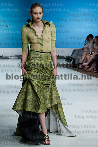 Model presents a creation by designer Marta Makany during the Essential Looks fashion show in Budapest, Hungary on April 30, 2011. ATTILA VOLGYI
