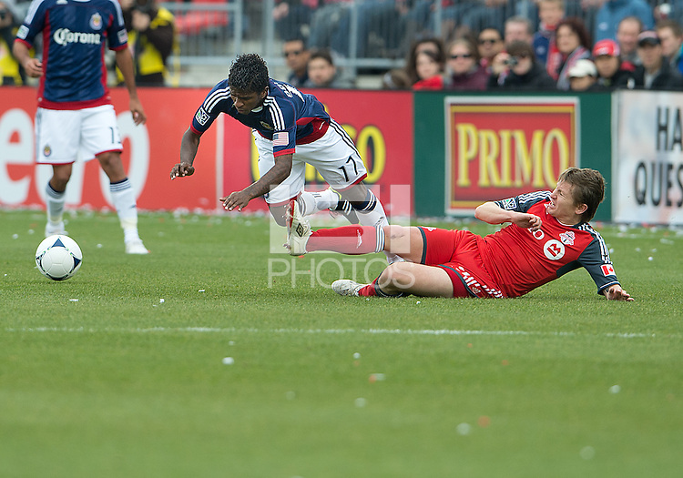 14 April 2012: Chivas USA midfielder Miller Bolanos #17 and Toronto FC midfielder Terry Dunfield #23 in action during a game between Chivas USA and Toronto FC at BMO Field in Toronto..Chivas USA won 1-0.