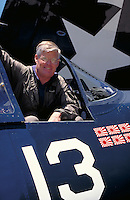 Capt. Vaughn Olson of the Confederate Air Force in the cockpit of the F4U Corsair he pilots. The historic group maintains and flies WWII era aircraft. Aviation, Museums, Historical. Vaughn Olson. Dallas TX USA.