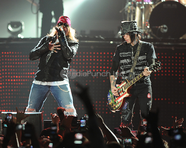 MIAMI, FL - OCTOBER 29:  Axl Rose and DJ Ashba of Guns N' Roses perform at American Airlines Arena on October 29, 2011 in Miami, Florida. Credit: MediaPunch Inc.