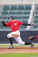 Adam Engel (23) of the Kannapolis Intimidators follows through on his swing against the Greenville Drive at CMC-Northeast Stadium on April 6, 2014 in Kannapolis, North Carolina.  The Intimidators defeated the Drive 8-5.  (Brian Westerholt/Four Seam Images)