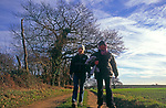 A293K7 Mother and daughter on winter country walk Suffolk England