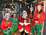 Elves Emma Skelly, Milly Callan and Saoirse Gilbert pictured with Santa and Bubbles in Ardee Castle. Photo:Colin Bell/pressphotos.ie